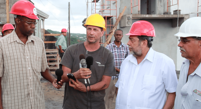 From left: Dr. Rudy Matthias of AIDC, Richard Lubang of Areonav, Prime Minister Dr. Ralph Gonsalves, and Bradley of Franco Construction. (IWN image)