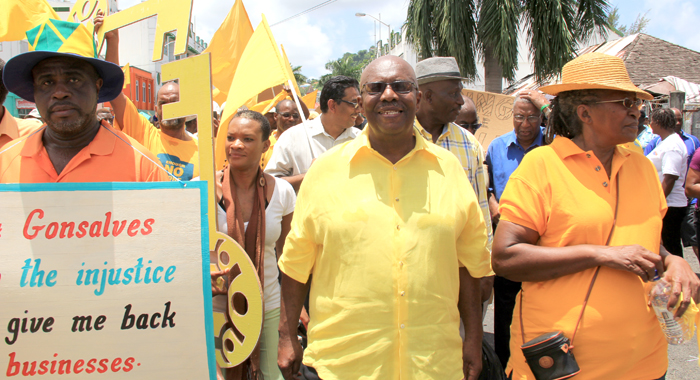 Leader of the Opposition Arnhim Eustace, centre, at the head of the march. (IWN photo)