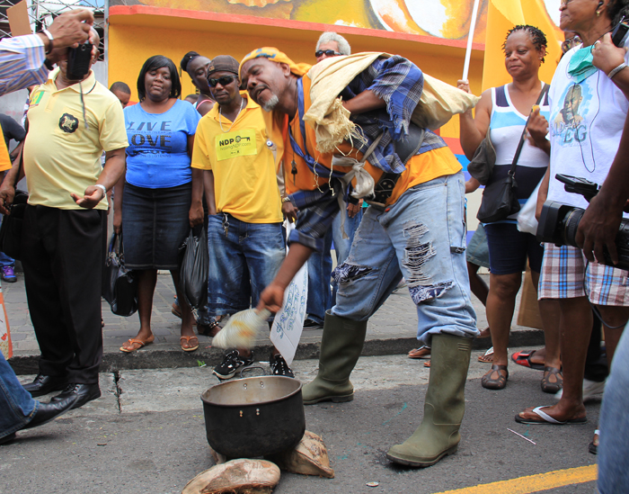 A farmer demonstrates in Kingstown during the NDP's protest march. (IWN photo)