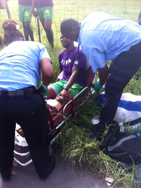 A Vincentian player is assisted after the accident in Antigua.
