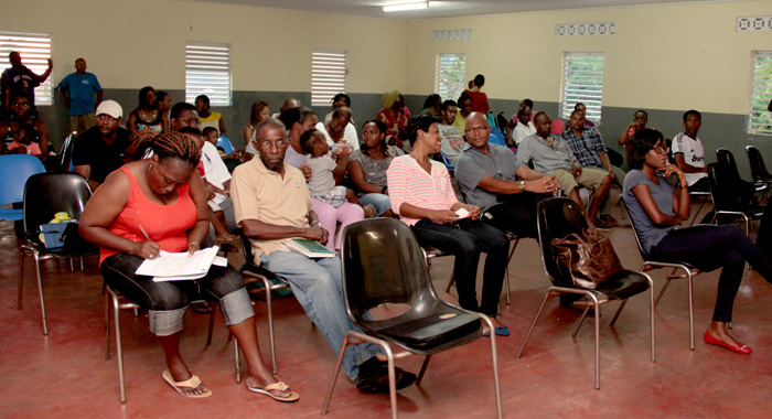 Homeowners, and other person, including MP for South Leeward, Nigel Stevenson (in grey t-shirt) at the meeting in Clare Valley on Saturday. (IWN photo)