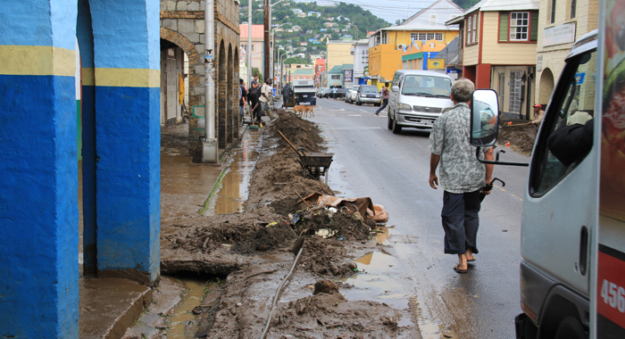 Workers clean debris from drains in Kingstown on Saturday. (IWN photo)