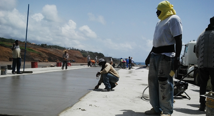 Workers involved in concrete pavement works at Argyle International Airport. (AIDC photo)