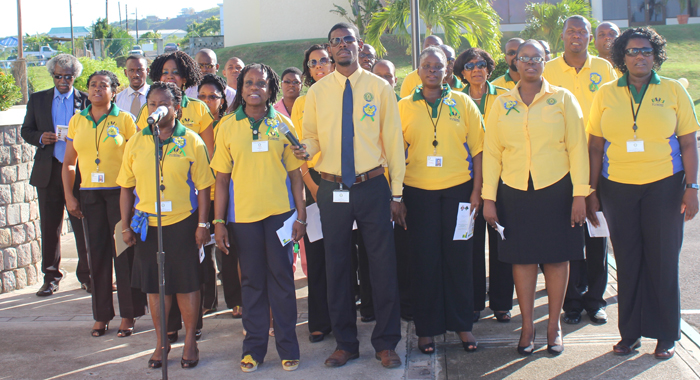 Vincentians participate in the flag raising ceremony. Sir Dwight, is at left, in suit.