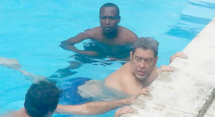 Pm Gonsalves, centre, as he was being treated in Cuba. Vincentian physiotherapist, Denis Byam is at left. (Photo: Facebook)