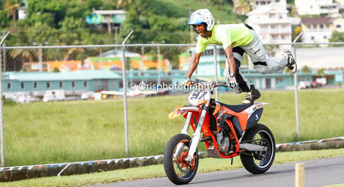 Martican motorcyclist Jeslin Emmanuel Gorearvia performs a stunt in Arnos Vale in October 2013. He died on Friday after an incident involving a truck in Arnos Vale.