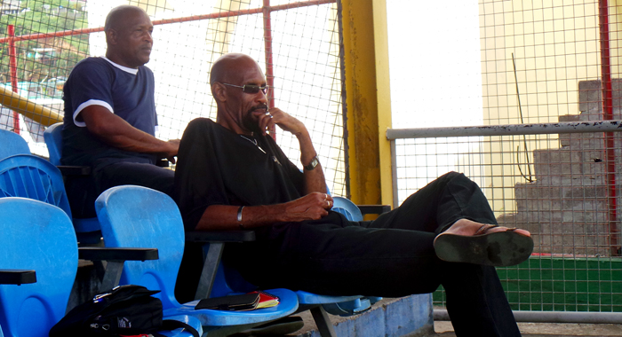 WATCH-MEN: Selectors Lance John, right, and Gosnel Cupid watch the action during the trial match. (Photo: E. Glenford Prescott)