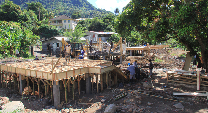 The HLDC has told its paying clients that their houses were delayed by the response to the December disaster. Since then the HLDC has built scores of free houses for disaster victims, including these under construction in Penniston. (IWN photo)