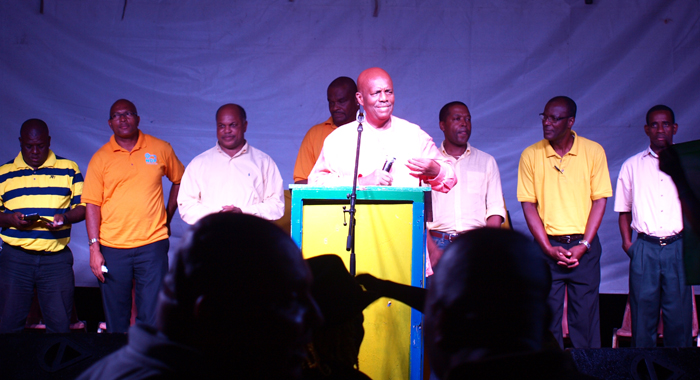 Opposition Leader Arnhim Eustace and other persons on the platform at the NDP meeting on Saturday. (IWN Photo)