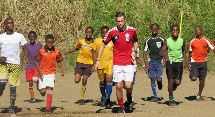 Members of the Kenville Horne Sports Academy being trained by German coach Elias Straiter.