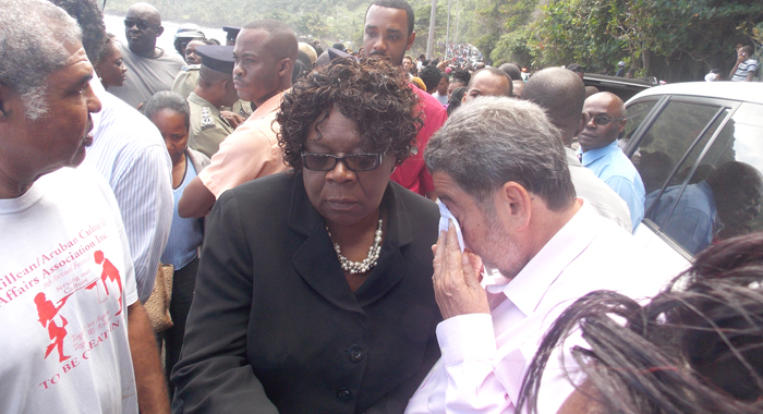 From left: MP for North Windward Montgomery Daniel, Minister of Education Girlyn Miguel, and Prime Minister Dr. Ralph Gonsalves at the scene in Rock Gutter on Monday. (IWN Photo)