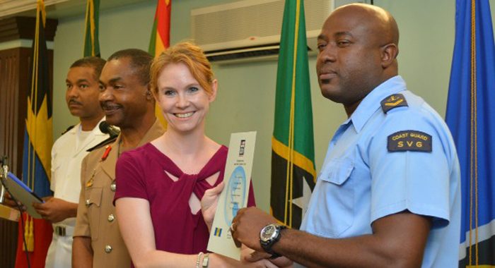 Clinton Lewis, right, from St. Vincent and the Grenadines receives his certificate of completion from Victoria Dean.