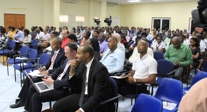 Executives of CWC and Columbus Communications at the consultation on Monday. (IWN photo)