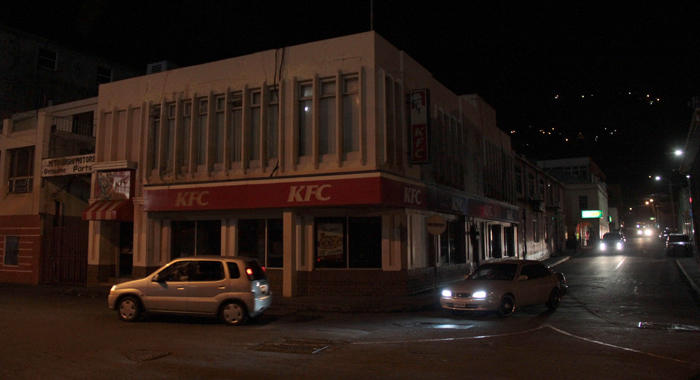 The KFC outlet in uptown Kingstown, like the two others, were closed and in darkness around 7 p.m. Monday. (IWN photo)