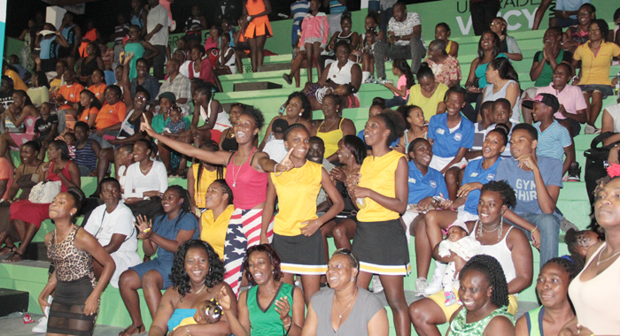 Spectators react to action in the exciting exhibition match. (IWN photo)