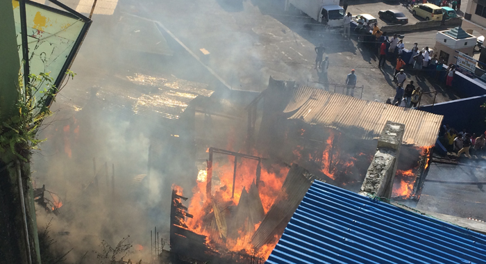 The fire destroyed two houses and damaged a further two. (IWN photo)