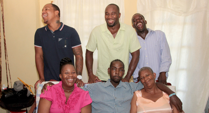 """W. Alex """"Nick"""" Chance, front centre, in what would be his last photo with all his siblings and parents, taken Dec. 21, 2014. Front left, sister Nakeisha Chance-John, front right, Patricia Chance-Hoyte. Back row (from left) brother,  Brenton Hoyte, Kenton X. Chance, and Myron Chance. (Photo: Zavique Morris-Chance)"""