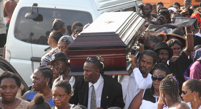 Relatives and friends carry Nick's casket shoulder-high to Chauncey Cemetery on Sunday. (Photo: Karamo John)