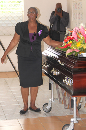 Nick's mother, Patricia Chance-Hoyte, touches her son's casket during the funeral service. (Photo: Karamo John)