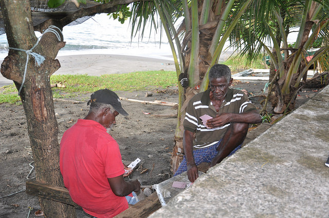 Grenadian fishermen Henry Prince (right) and Ralph Crewney see beachfront living as a virtual birthright, despite the risks posed by climate change. (Photo: Desmond Brown/IPS)