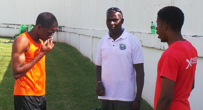 Coach Garth Deshong, centre,  with the Boyde twin at the start of training session at Victoria Park. (Photo: E. Glenford Prescott)