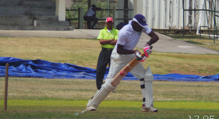 Police allrounder Kenneth Dember (60) steers to third man.