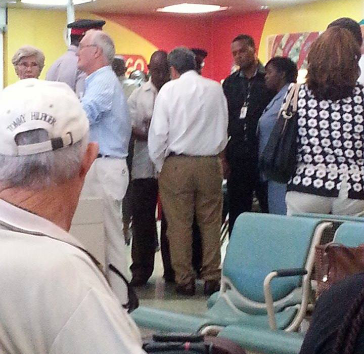 Prime Minister Dr. Ralph Gonsalves (centre in white shirt and brown pants) converse with GAIA officials after the incident.
