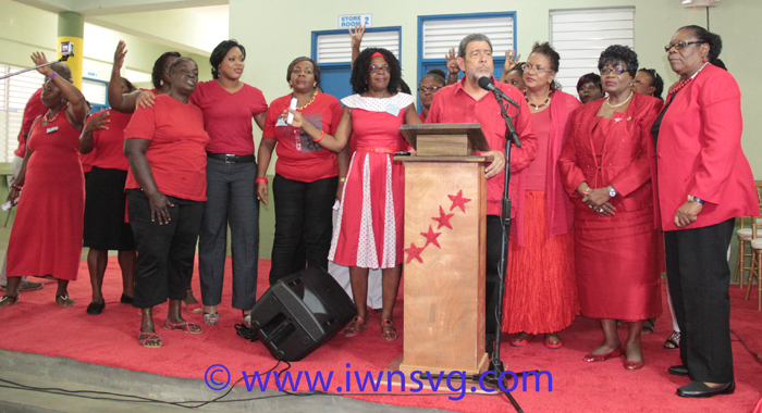 Gonsalves surrounded by women at the ULP Women's Arm convention on Sunday. (IWN photo)