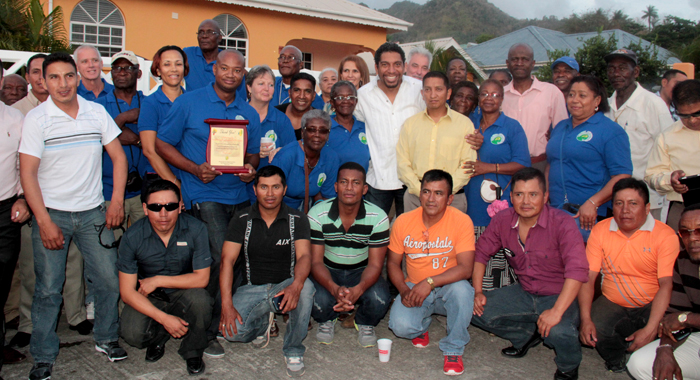 Minister of Foreign Affairs Sen. Camillo Gonsalves, MP for Central Leeward Maxwell Charles,  residents of Cane Grove and Ecuadorian Army engineers  at the dinner. (IWN photo)