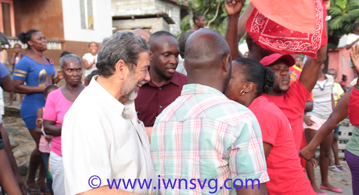 Prime Minister Dr. Ralph Gonsalves is greeted by supporters in Fitz Hughes on Friday. (Photo: Zavique Morris-Chance)
