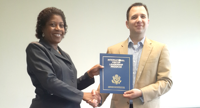 Findlay-Joseph receives her  certificate of participation from Scott R. Van Alstine, programme officer, U.S. Depart of State.