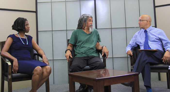 From left: Indi Mclymont-Lafayette, country coordinator, Jamaica of Panos Caribbean, St. Lucian poet Kendel Hippolyte, and Permanent Secretary in the Ministry of Sustainable Development, Sylvester Clauzel. (IWN photo)