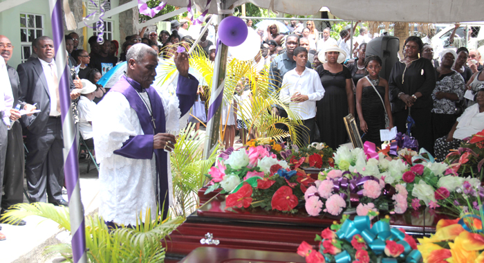 Bishop Ashton performs rites at the funeral in Spring Village on Sunday. (IWN photo)