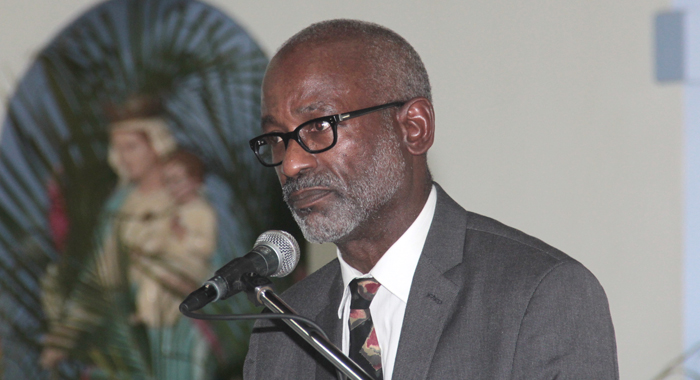 Neurosurgeon Dr. Phillip St. Louis speaking at the funeral of Nicole Sylvester. (IWN photo)