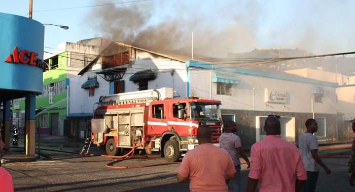 Firefighters respond to the blaze in Kingstown on Sunday. (Photo: Karamo John/IWN)