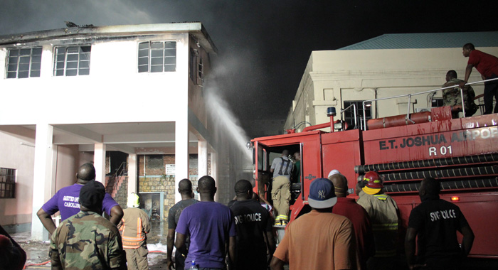 A fire truck from E.T. Joshua Airport helped to put out the blaze. (IWN photo)