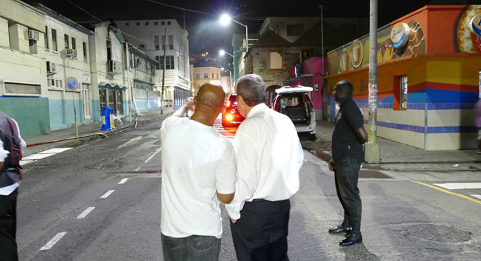 Prime Minister Dr. Ralph Gonsalves, right, and Deputy Commissioner of Police Reynald Hadaway, speak at the scene of the fire. (Photo: Jamali Jack/Facebook)