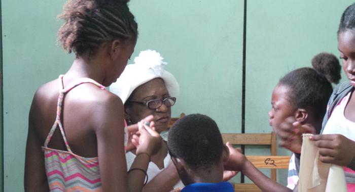 Velma Scott teaching needlework at the summer programme. (Photo: E. Glenford Prescott)