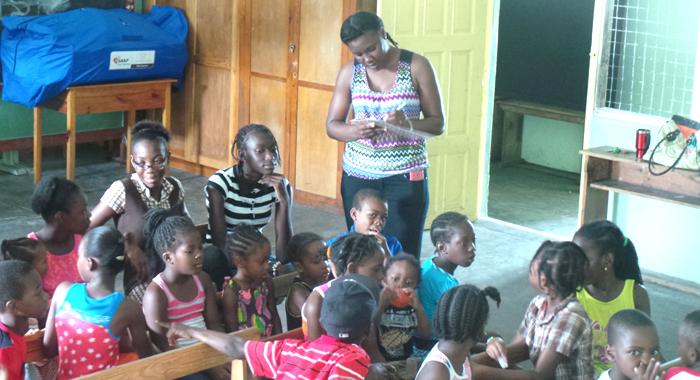 Registration of children at Kimesha Davis' summer programme in August. (Photo: E. Glendord Prescott)