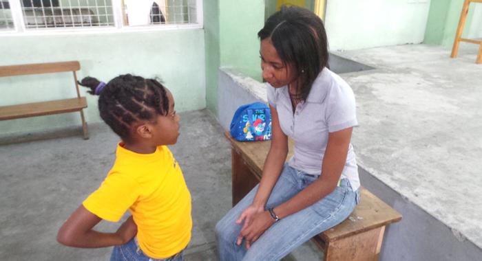 Teacher Balcombe chats with a student during Kimesha Davis' summer programme. (Photo: E. Glendord Prescott)