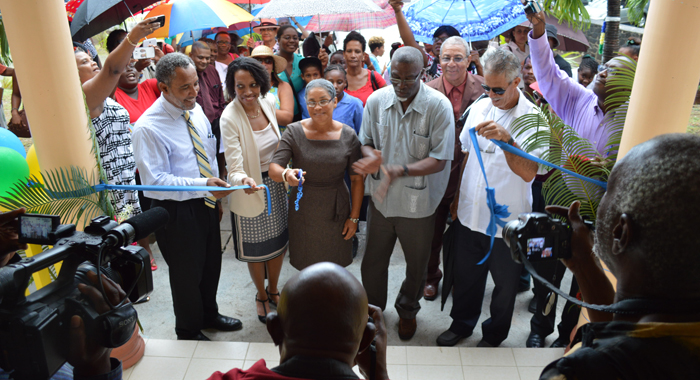 Cutting the ribbon during the handover and opening ceremony of the Bequia Hospital on Oct. 8, 2015. From left: Dr. Godwin Friday, Parliamentary Representative for the Northern Grenadines; Sister Reanna Olliviere; Darran Newman, Portfolio Manager, BNTF, CDB; Clayton Burgin, Minister of Health and the Environment; Herman Belmar, Deputy Director Grenadines Affairs.