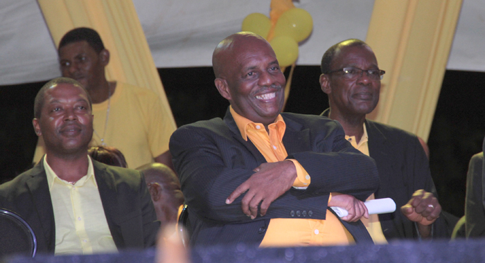 NDP leader Arnhim Eustace, centre, at a campaign rally last November. Leacock believes that West Kingstown MP, Daniel Cummings, right, also has what it takes to become leader of the party. (IWN file photo)
