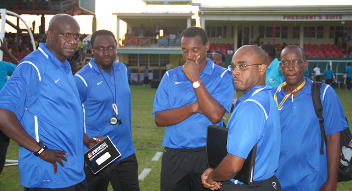 Vincy Heat's technical team reacts after the 4-0 loss on Tuesday. Coach Hendrickson is far left. (IWN photo)