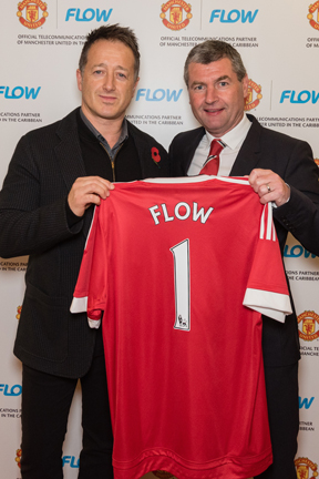 John Reid, president of Cable and Wireless Communication's consumer group with United legend Denis Irwin.