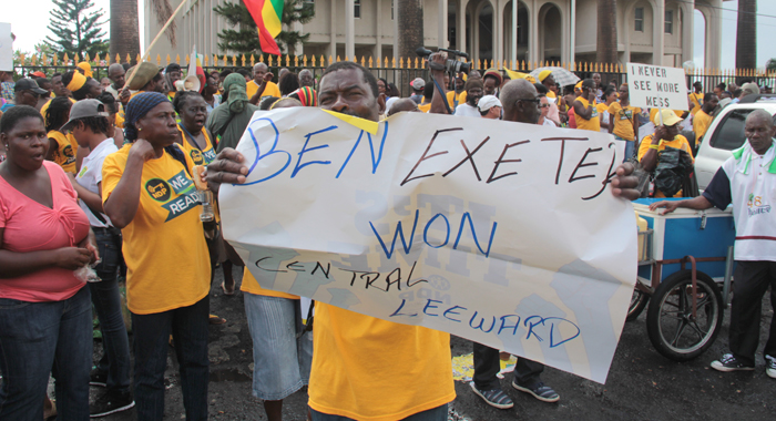 NDP supporters protested ahead of and during the ceremony in Kingstown on Monday. (IWN photo)
