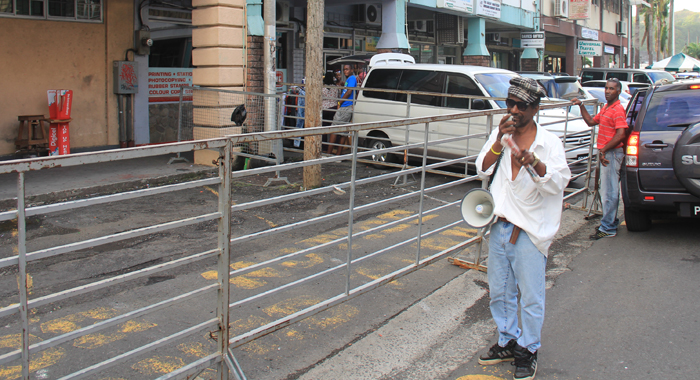 "NDP activist Robert ""Patches"" Knights has continued a virtual one-man protest outside the Electoral Office in Kingstown. He is seen her shortly after 5 p.m. Wednesday. (IWN photo)"