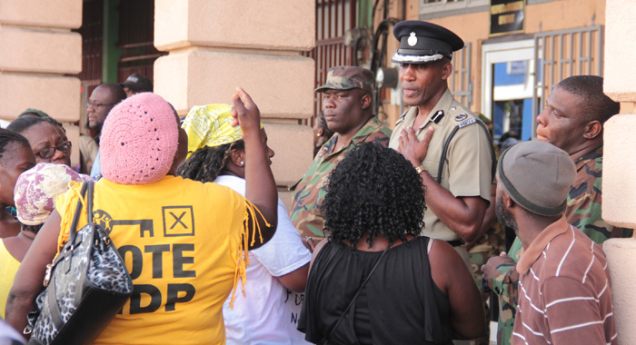 ACP Benjamin interacts with protesters some time after Mark's arrest. (IWN photo)