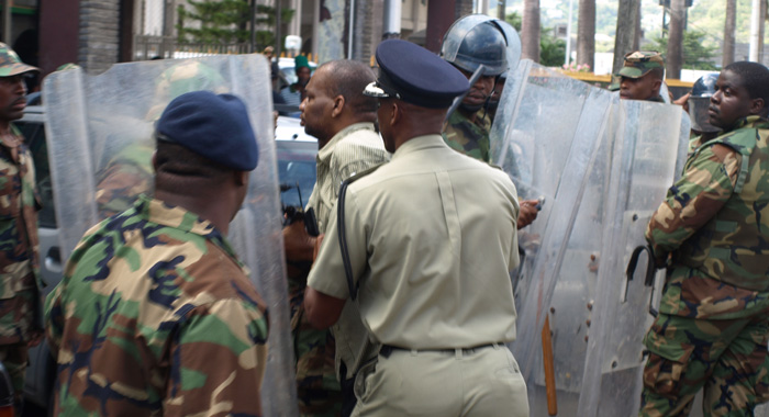 ACP Christopher Benjamin instructs officer to take Mark into custody. (IWN photo)