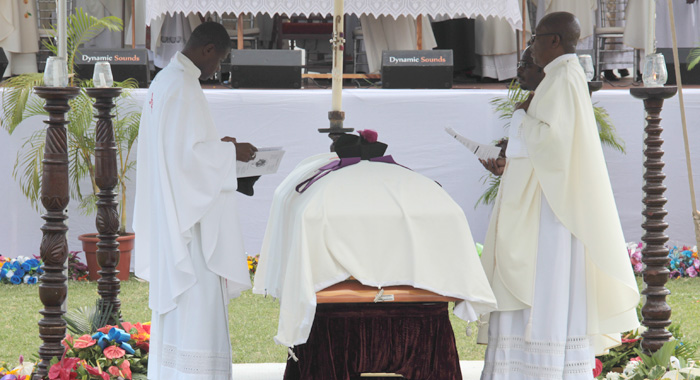 Clerics stand over McIntosh's casket at his funeral on Friday. (IWN photo)