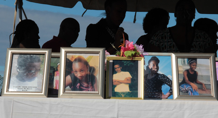 Portrayed of the students on display at the memorial service on Tuesday. (IWN photo)